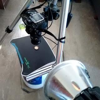 coin photography setup using a single light