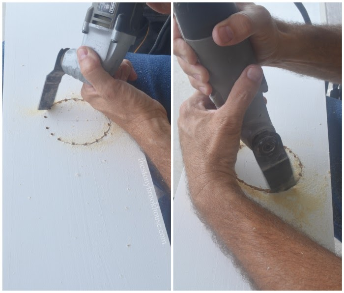 Hubby cutting hole in board for light fixture