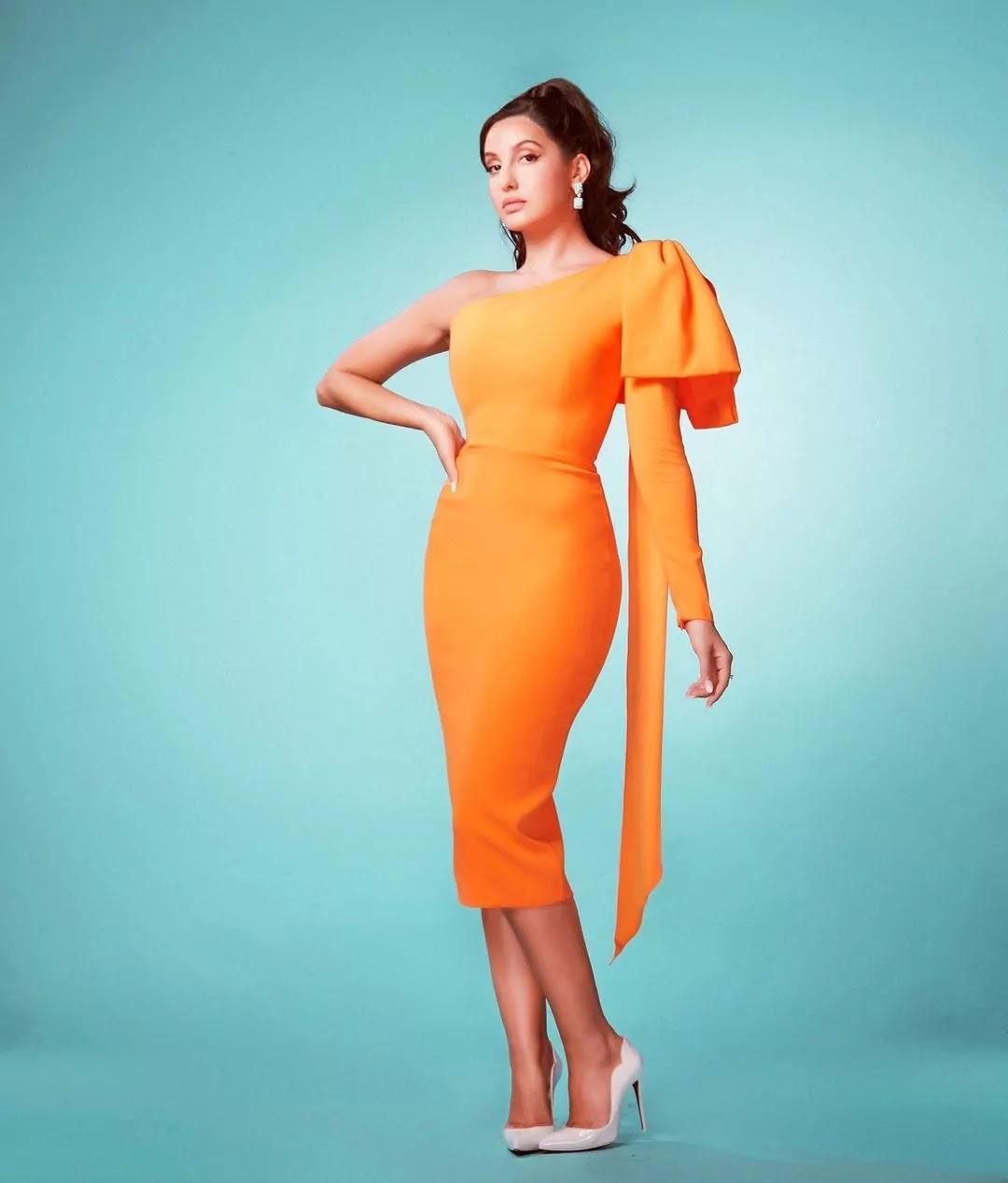 nora-fatehi-hot-looks-in-orange-bodycon-dress
