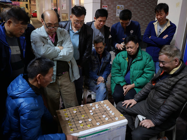 men playing a xiangqi variant in Mong Kok, Hong Kong