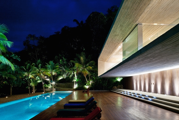 Terrace of Modern beach house in Brazil by Marcio Kogan  at night