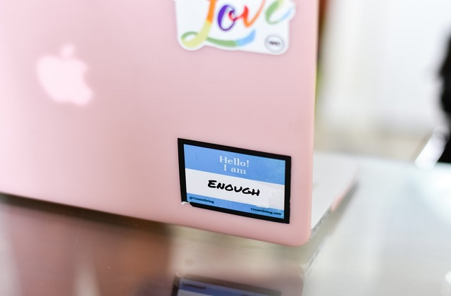 pink macbook with love and positive sticker