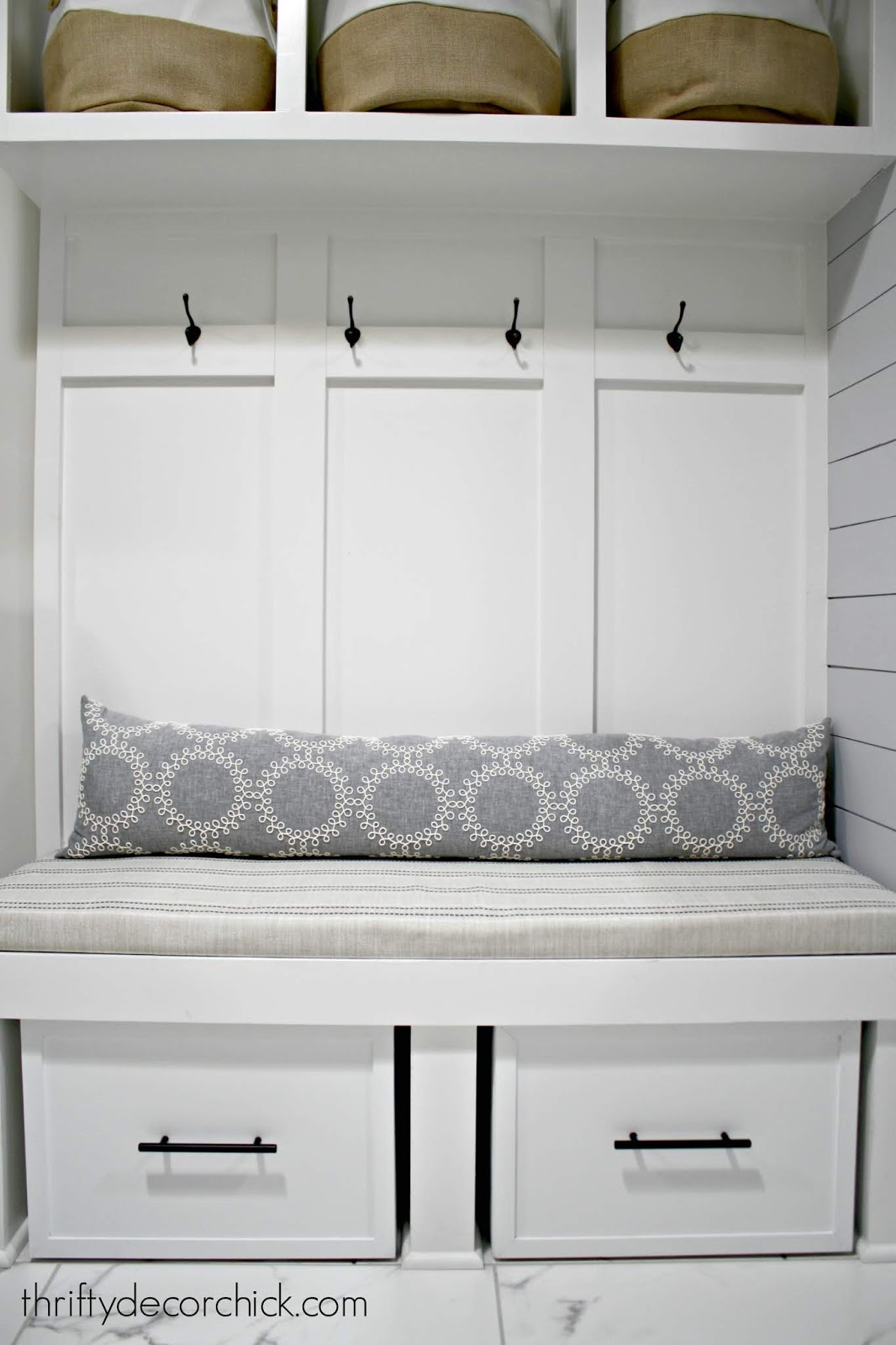 Mud room bench with sliding shoe storage