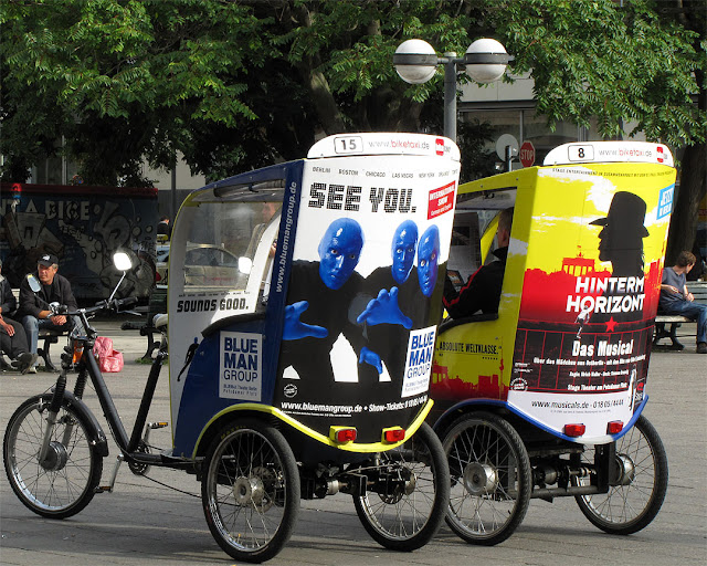 Blue Man Group and Hinterm Horizont ads on pedicabs, Panoramastraße, Berlin