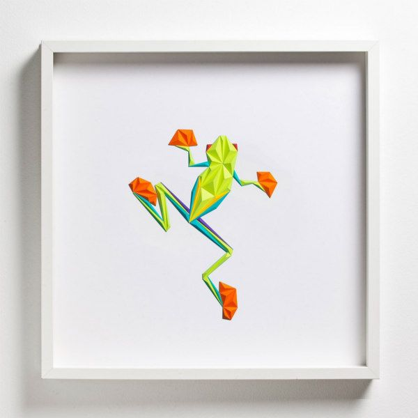 dimensional splay-legged frog made of colorful folded paper triangles in square white frame on wall