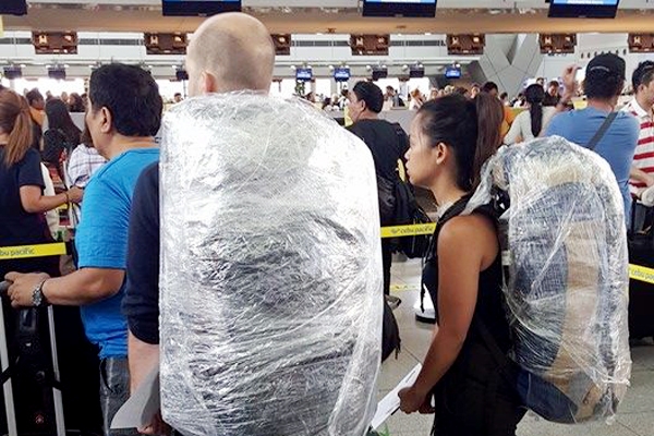 TANIM-BALA EFFECT? Some Pinoys, foreigners sealed their baggage at NAIA