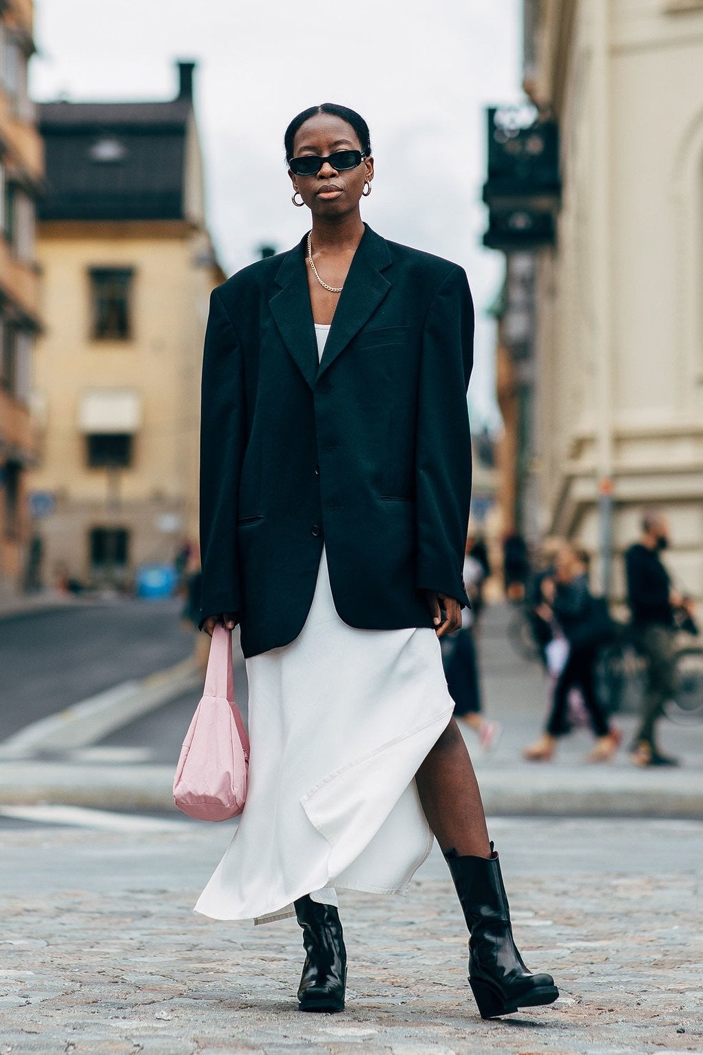 White Dress Spring Outfit Inspiration — Sylvie Mus Street Style — Black blazer, white slip dress, pink bag, and Western boots