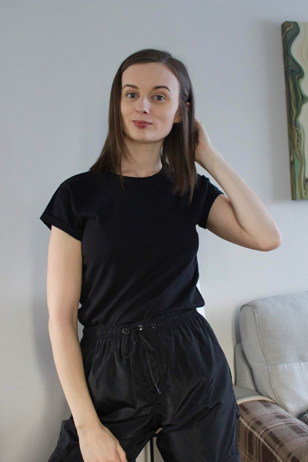 Claire wearing oversized black tee and cargo pants.