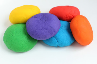 Learn how to make playdough with this simple recipe. You will need flour, salt, cream of tartar, vegetable oil, water and Kool Aid packets.