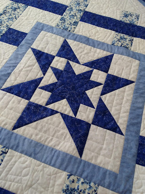 quilted blue and white double star patchwork block