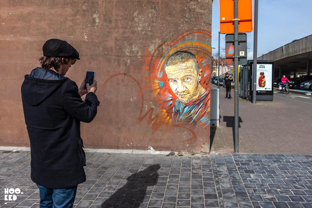 Bjørn Van Poucke photographing the stencil work of French Street Artist C215