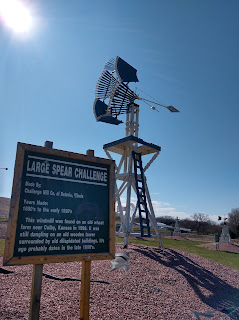 an antique windmill from the Sentinels of the Prairie collection with a sign identifying it as a Large Spear Challenge