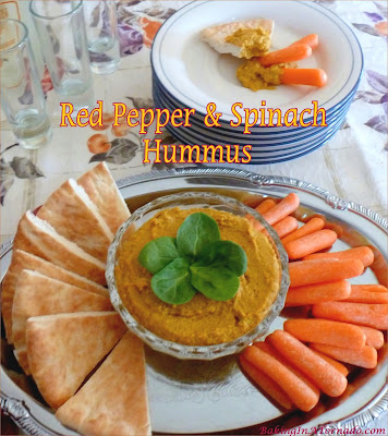 Red Pepper Spinach Hummus comes together in minutes in a blender or food processor. Roasted Red Peppers and fresh spinach add to the flavor of a basic hummus. | Recipe developed by www.BakingInATornado.com | #appetizer #vegetables