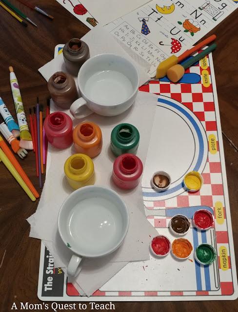 paint, paintbrushes, paper
