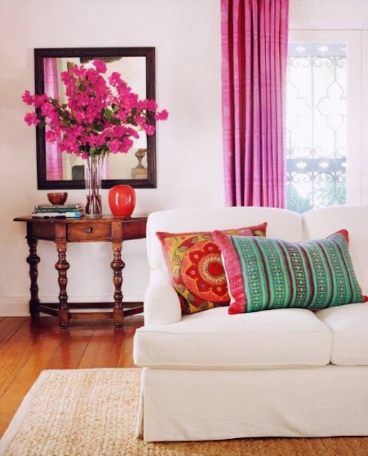 colorful cushion with pink curtains