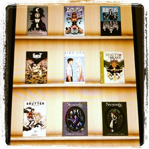 Nine digital comics arrayed on a digital bookshelves. They're listed below.