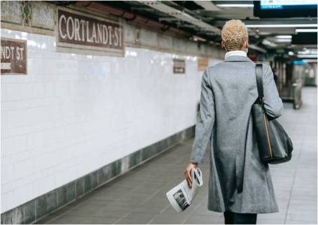 a woman walking in the NYC subway, representing opportunities for women entrepreneurs in New York City