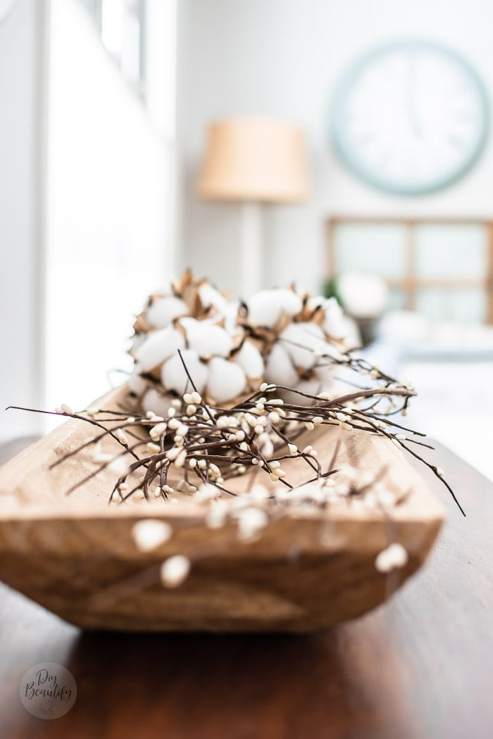 dough bowl filled with white pip berry garland and cotton bolls