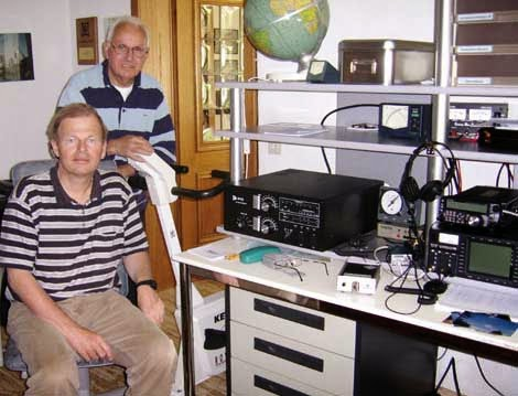 CP4BT ( sitting ) by a visit at his QSL manager Hermann, DJ2BW (standing )in Germany