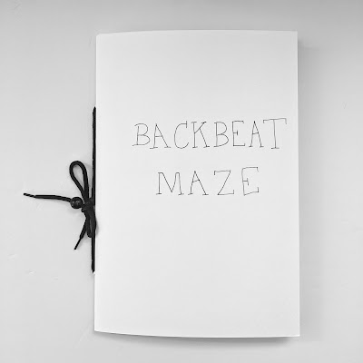"Backbeat Maze cover with a thin font with simple lettering that says ""Backbeat Maze."""