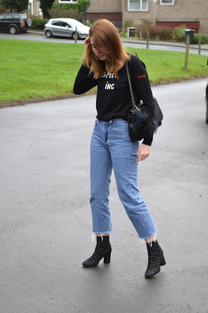 Bella freud jumper from Fred perry, Blue vintage Levis 501 with black studded boots from ASOS. Mulberry style bag with river island pom pom. Affordable women's fashion blog. Alexa chung style. Vogue