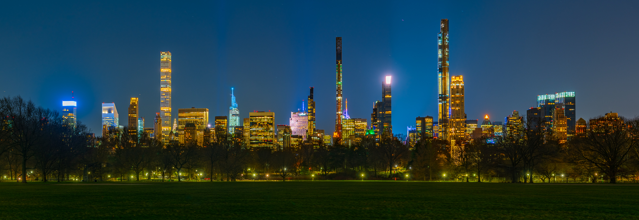 a panoramic night photo of central park south new york city