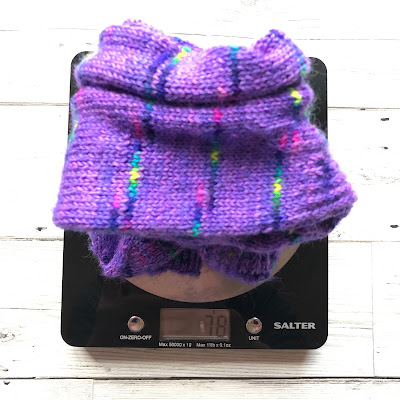 Pair of handknitted socks on a set of digital scales