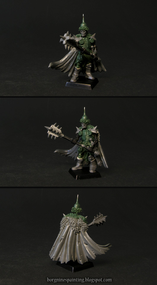An unpainted, kitbashed Wight King miniature, carrying a two-handed mace, with a flowing cape and armor made out of greenstuff.