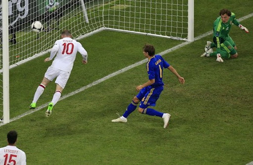 England forward Wayne Rooney heads the ball into an empty net to score against Ukraine