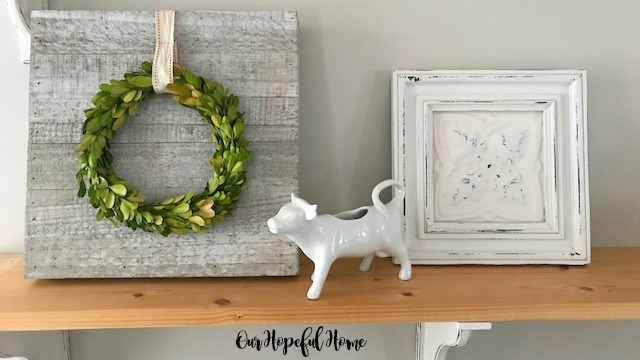 painted distressed vintage ceiling tile wall art boxwood wreath porcelain cow creamer