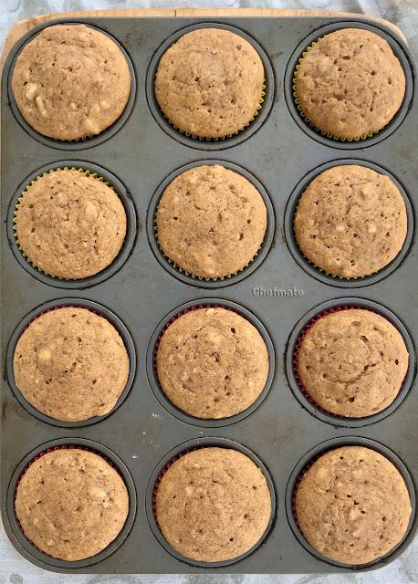 Muffin pan full of sourdough pumpkin walnut muffins.