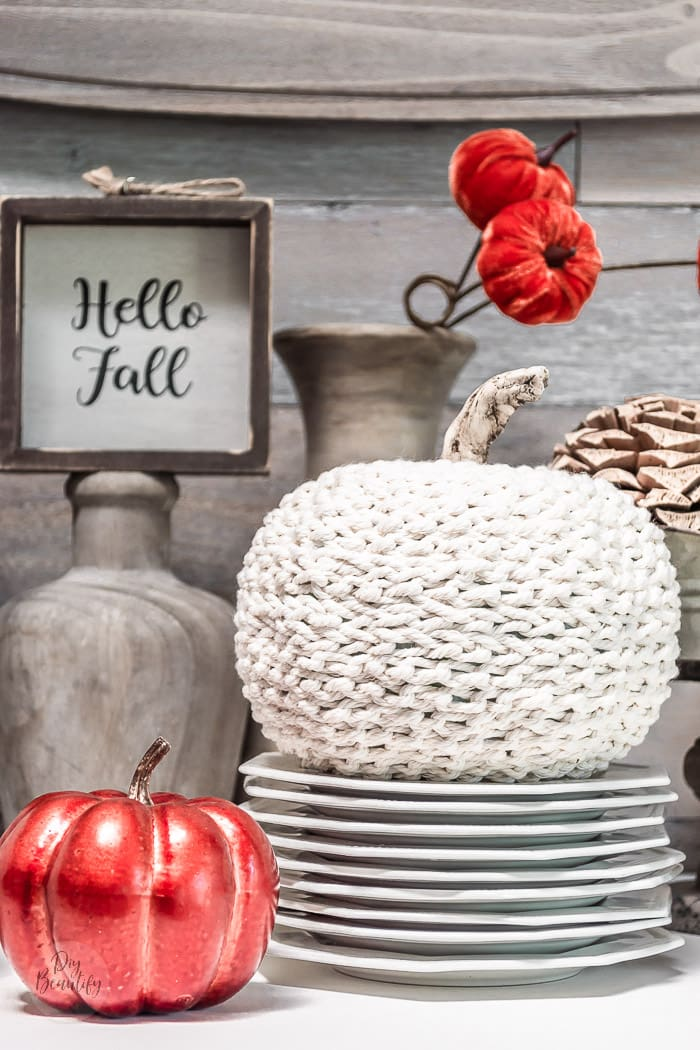 crochet chain pumpkin on stack of ironstone plates