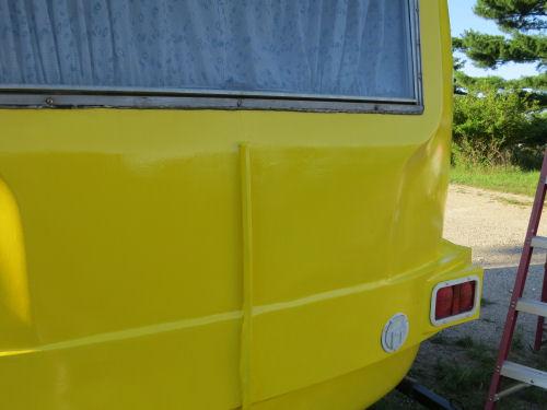 back of fiberglass trailer painted yellow