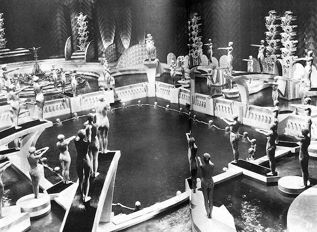 Busby Berkeley cinematic choreography, bathing beauties diving into a pool