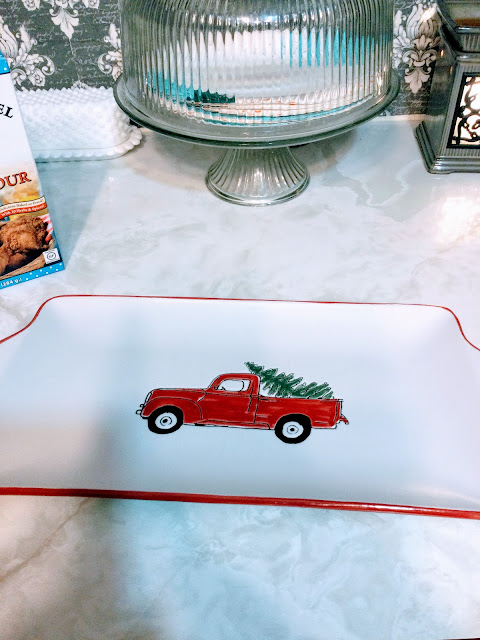 Red truck with tree in bed platter
