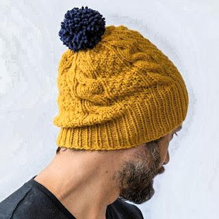 7) Hat with pom poms