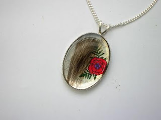 Sterling silver poppy pendant for a lock of hair