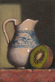 Still life oil painting of a blue and white jug beside a kiwi fruit half.