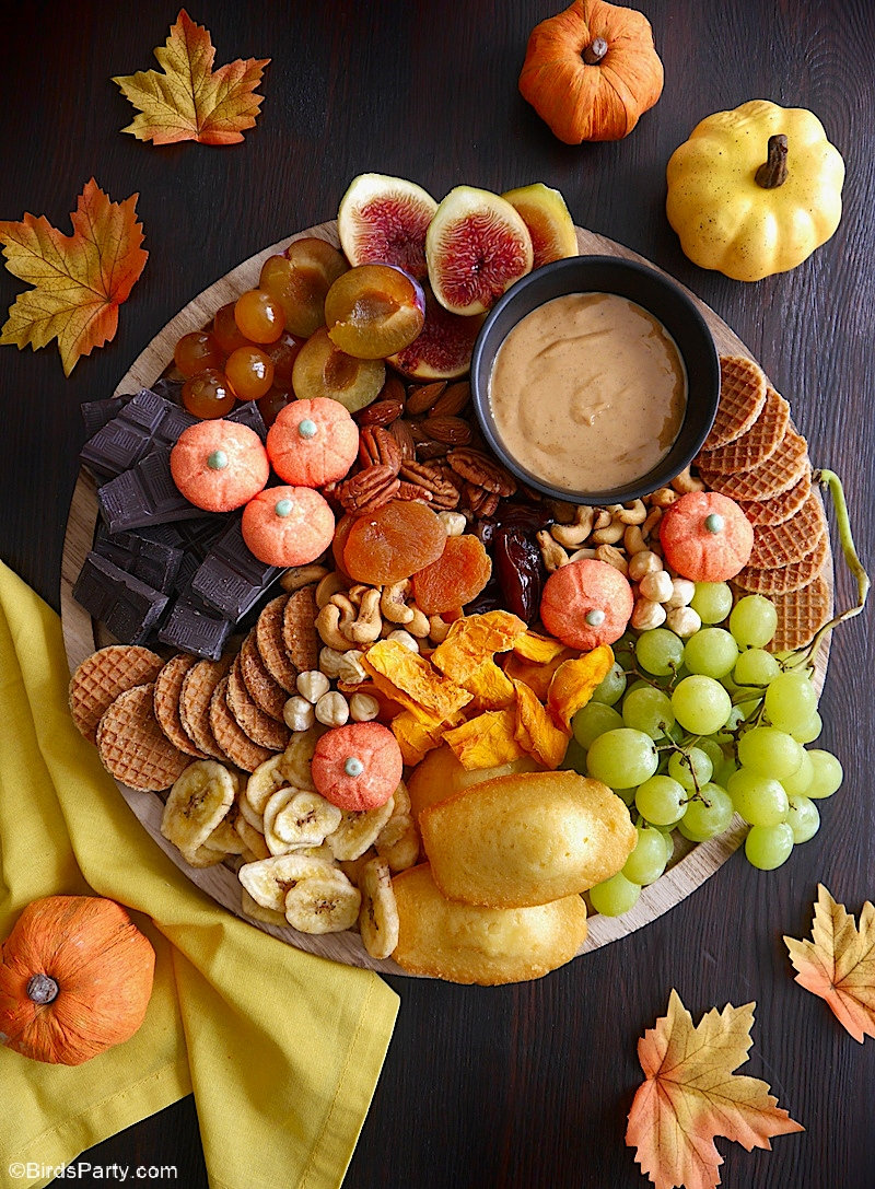 Quick & Easy Chocolate Grazing Board for Fall - a delicious and bountiful platter filled with seasonal produce, perfect for serving on Thanksgiving! by BirdsParty.com @birdsparty #chocolate #thanksgiving #freindsgiving #nobakedessert #grazingboard #charcuterieboard #treatsboard #dessertsboard #dessertsplatter #grazingplatter #sweet