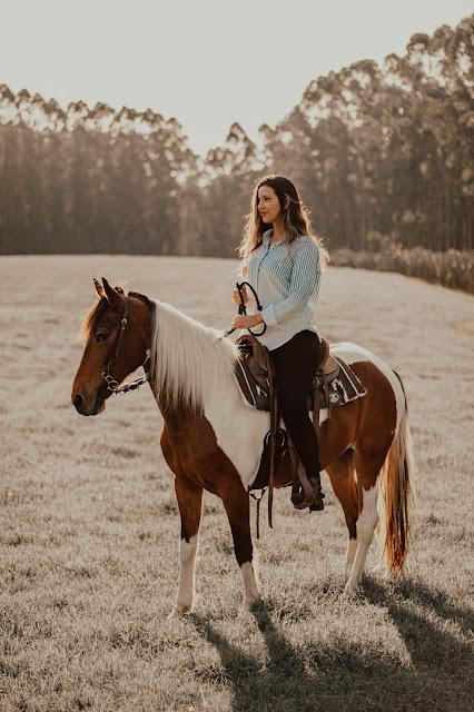 Woman riding horse: Photo by Paula Palmieri on Unsplash