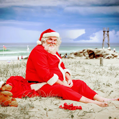 image a Santa on the beach overcoming fear of water when you learn how to swim and Christmas.