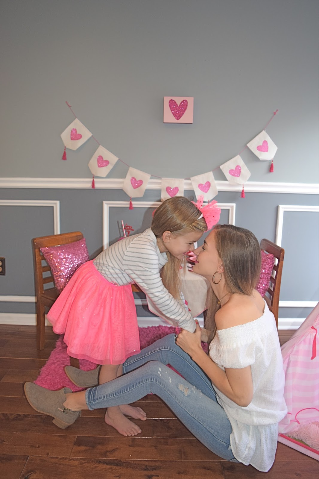 Kids Valentine's day party, kids valentines day party idea. Girls heart party, Girls pink heart party. Our generation teepee, sequin pillows, girls in pink tutu for party, hot pink paper straws, valentines day ombre rose cake, girls pink party ideas