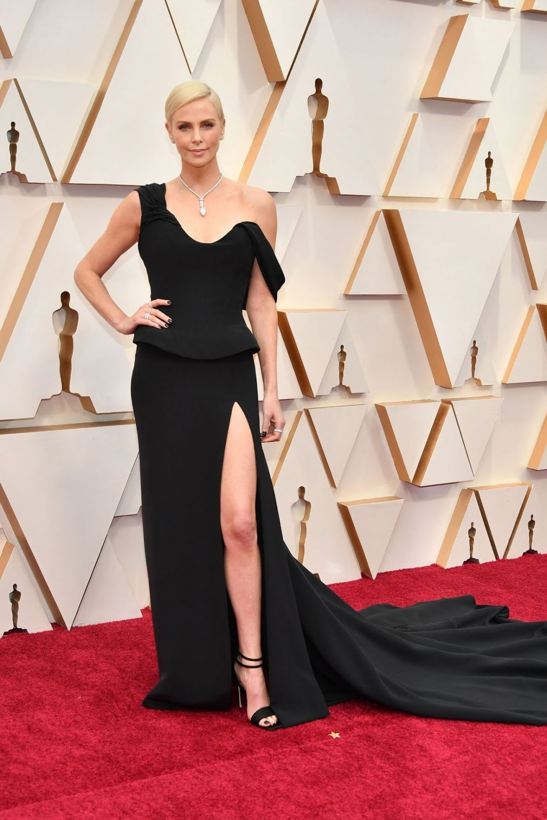 Charlize Theron channels Old Hollywood glam in a black Dior couture gown at the Academy Awards