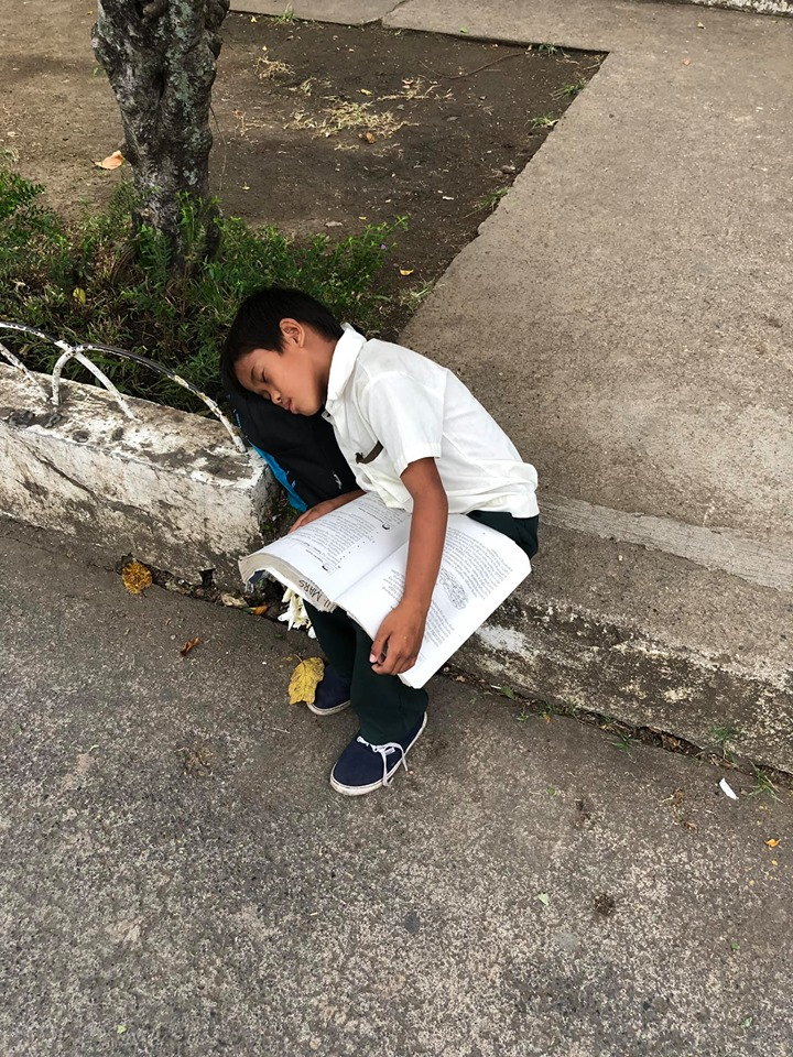 Kid falls asleep while studying, selling sampaguita