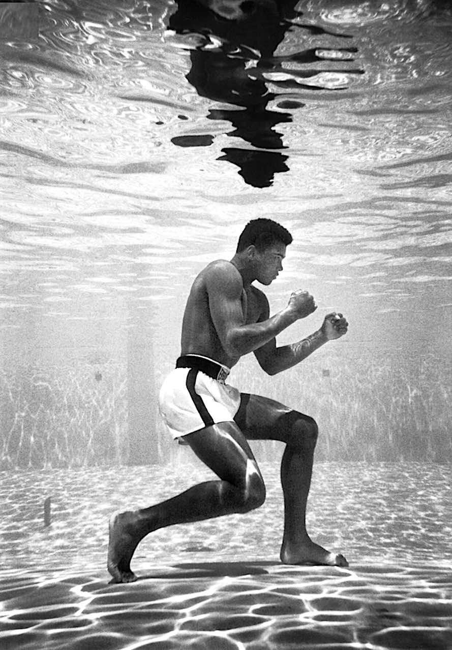 a 1961 photograph of Muhammad Ali by Flip Schulke