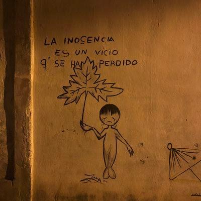 La Habana de noche. Barrio Pueblo Nuevo. Grafitti. La inocencia es un vicio que se ha perdido