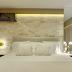 Quarto com parede de tijolinhos travertino e cores claras: branco, bege e dourado!