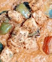 Mixing paneer Tikka with gravy for paneer tikka masala recipe