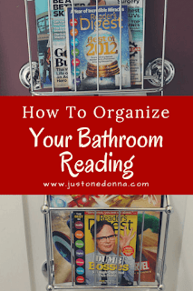 Use Wall-Mounted Magazine Racks to Organize Your Bathroom