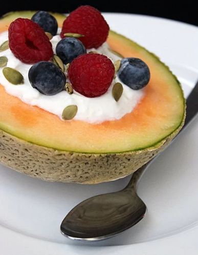 Melon cantaloupe garnished with yogurt